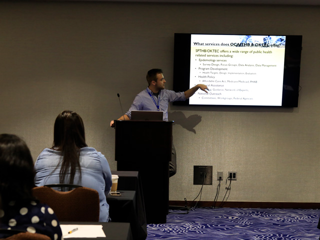 Tyler Dougherty presenting at a Day 1 outbreak session